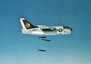 A-7E_VA-25_dropping_bombs_over_Vietnam_c1970