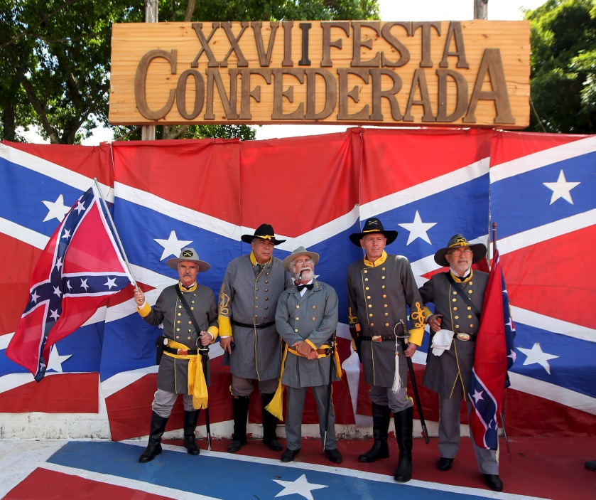 Descendants of American Southerners wearing Confederate-era uniforms pose for a photograph during a party to celebrate the 150th anniversary of the end of the American Civil War in Santa Barbara D'Oeste, Brazil