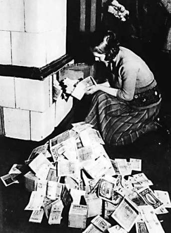 woman-burning-cash-for-heat
