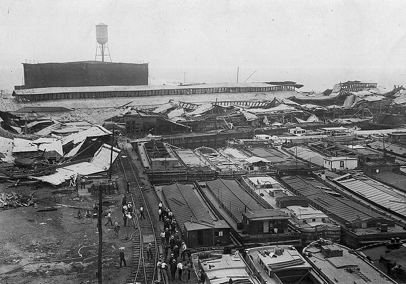 Wrecked_warehouses_and_scattered_debris_after_the_Black_Tom_Explosion,_1916
