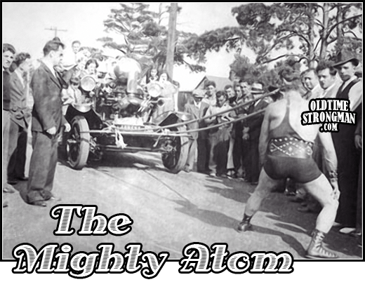 the_mighty_atom_pulls_firetruck_with_hair