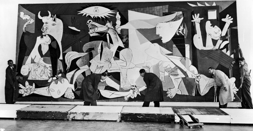 Guernica-by-Pablo-Picasso-in-Amsterdam-being-hung-in-the-Municipal-Museum-12th-July-1956.-KeystoneHulton-ArchiveGetty-Images