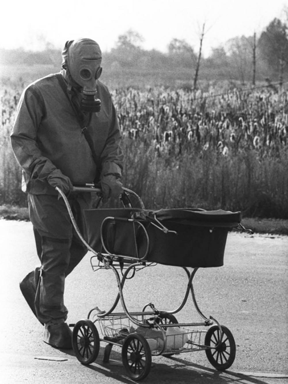 A Chernobyl liquidator pushes a baby in a carriage who was found during the cleanup of the Chernobyl nuclear accident, 1986.jpg